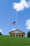 Flag half way up in Arlington Cemetery stock image