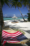 Flag hammock boracay beach philippines. Towel draped over rattan hammock under palm trees of boracay island in the philippines Stock Photography