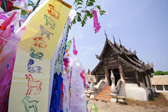 Flag hang Songkran Festival. One of the traditions of northern T. Hailand. The Hang Tung and colorful embroidery. The pagoda is made of sand with detail stock photography
