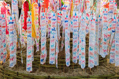 Flag hang Songkran Festival. The Hang Tung and colorful paper. The pagoda is made of sand Royalty Free Stock Photography