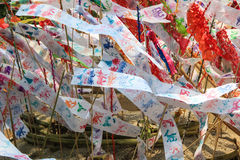 Flag hang Songkran Festival. The Hang Tung and colorful paper. The pagoda is made of sand Stock Photography
