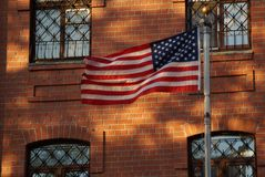 The flag is in harmony with the elements of the facade. stock image