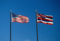 Flag of Hawaii. State Flag of Hawaii against the blue sky stock photo