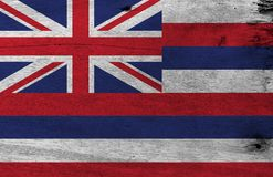 Flag of Hawaii on wooden plate background. Grunge Hawaii flag texture, The states of America. stock photo