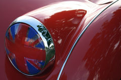 Flag headlight cover on vintage British race car. Detail of flag headlight cover on vintage British race car Royalty Free Stock Photo