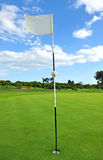 Flag in the hole of the golf course, Andalusia, Spain Royalty Free Stock Photo