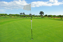 Flag in the hole of the golf course, Andalusia, Spain Stock Images