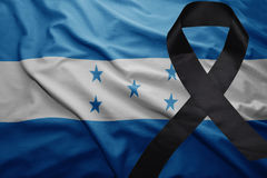 Flag of honduras with black mourning ribbon Stock Photo