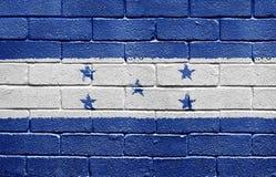 Flag of Honduras on brick wall. Flag of Honduras painted onto a grunge brick wall Royalty Free Stock Image