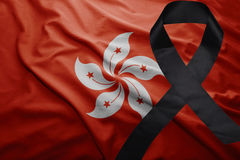 Flag of hong kong with black mourning ribbon. Waving national flag of hong kong with black mourning ribbon Stock Photos