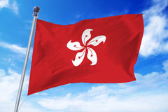 Flag of Hong Kong developing against a blue sky Royalty Free Stock Photos