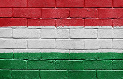 Flag of Hungary on brick wall stock images
