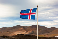 The flag of Iceland. Waving in the windon a background of a stormy sky Royalty Free Stock Photography