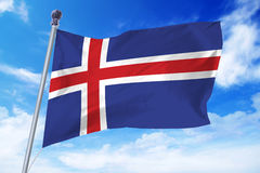 Flag of Iceland developing against a clear blue sky Stock Photo