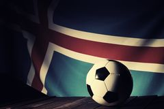 Flag of Iceland with football on wooden boards. Royalty Free Stock Images