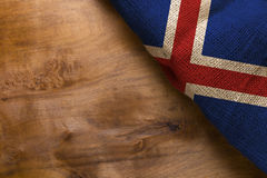 Flag Iceland on wooden background Stock Image