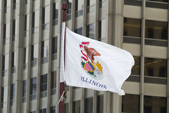 Flag of the Illinois in front of the Trump tower in Chicago Royalty Free Stock Photos