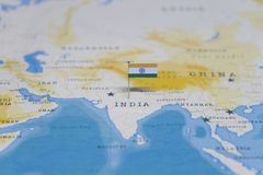 The Flag of india in the world map.  royalty free stock photo