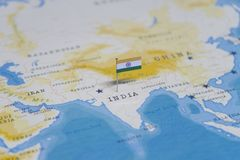 The Flag of india in the world map.  royalty free stock image