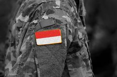 Flag of Indonesia on soldiers arm. Flag of Indonesia on military. Uniforms. collage stock photos