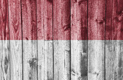 Flag of Indonesia on weathered wood stock photos
