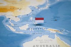 The Flag of indonesia in the world map royalty free stock photography