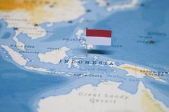 The Flag of indonesia in the world map.  royalty free stock photography