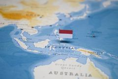 The Flag of indonesia in the world map stock photography