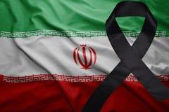 Flag of iran with black mourning ribbon. Waving national flag of iran with black mourning ribbon Stock Image