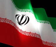 Flag of Iran in the dark with brightness spot Royalty Free Stock Photography