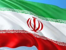 Flag of Iran waving in the wind against deep blue sky. High quality fabric royalty free stock images