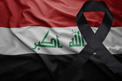 Flag of iraq with black mourning ribbon. Waving national flag of iraq with black mourning ribbon Stock Photos