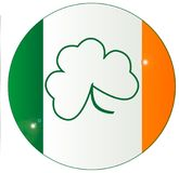 Irish Flag With Shamrock Button. The Flag of Ireland with an added lucky shamrock in the centre on a button Royalty Free Stock Image