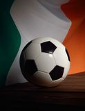 Flag of Ireland with football on wooden boards. Stock Photography