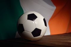 Flag of Ireland with football on wooden boards. Royalty Free Stock Photos