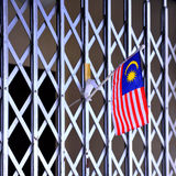 Flag on the Iron Gate. A small flag of Malaysia was inserted on the iron gate Stock Image