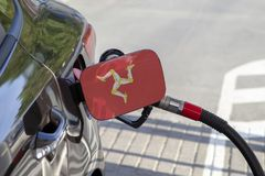Flag of Isle of Man on the car`s fuel filler flap. stock photography