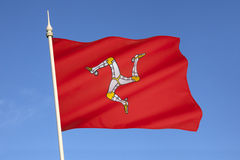 Flag of the Isle of Man - United Kingdom. The flag of the Isle of Man is a triskelion, composed of three armoured legs with golden spurs. It has been the Royalty Free Stock Photos