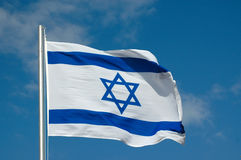 Flag of Israel. The blue and white national flag of Israel blowing in the wind Stock Images