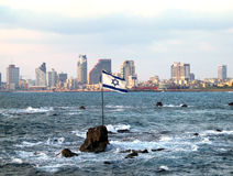 Flag of Israel on the Andromeda rocks on the background Stock Photos