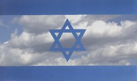 Flag of Israel a background of blue sky and clouds. Closeup Royalty Free Stock Images