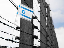 Flag of Israel on the barbwire Royalty Free Stock Photo