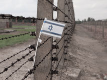 Flag of Israel in the fence of concentration camp Royalty Free Stock Image