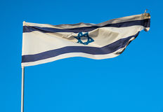 Flag of Israel. Israelian flag against blue sky in Tel Aviv, Israel Royalty Free Stock Photos