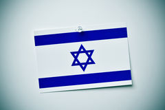 Flag of israel pinned on a wall Stock Photos