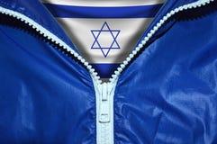 Flag of Israel under unpacked zipper stock images