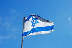Flag of Israel waving in the wind royalty free stock image