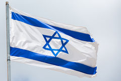 Flag of Israel waving on the wind Stock Photo