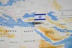 The Flag of israel in the world map royalty free stock photo