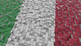 Flag of Italy being made with jigsaw puzzle pieces. Italian problem solution conceptual 3D rendering. Flag made of puzzle pieces, conceptual 3D stock illustration